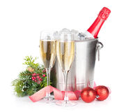 Champagne bottle in ice bucket, two glasses and christmas decor Stock Photography