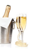 Champagne bottle in ice bucket, two glasses and christmas decor Royalty Free Stock Photos