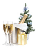 Champagne bottle in ice bucket, two glasses and christmas gift Stock Photography
