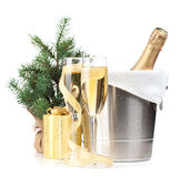Champagne bottle in ice bucket, two glasses and christmas gift Royalty Free Stock Photos