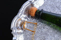Champagne Bottle Laying on Tray Stock Photos