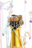 Champagne bottle and party streamers Stock Images