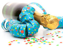 Champagne bottle with party utensils Stock Image