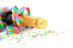 Champagne bottle with party utensils Royalty Free Stock Photos