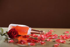 Champagne bottle with petals Stock Image