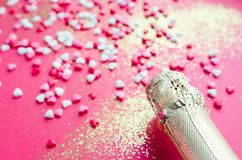 Champagne bottle on pink background stock photos