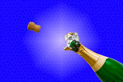 Champagne bottle pops. A cork flying out of a Champagne bottle isolated on a blue stained glass like background Royalty Free Stock Images