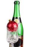 Champagne bottle and red ball Royalty Free Stock Photos
