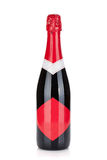 Champagne bottle with red label Royalty Free Stock Photography