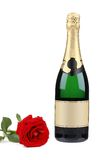 Champagne bottle and red rose. Isolated on a white background Royalty Free Stock Photography