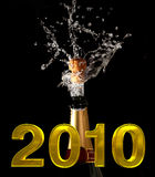 Champagne bottle with shotting cork. Background 2010 Stock Photography