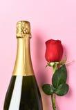 Champagne Bottle Single Rose Fotografía de archivo libre de regalías