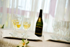 Champagne bottle with six filled glasses Stock Image