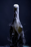 Champagne bottle with smoke Royalty Free Stock Images
