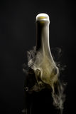 Champagne bottle with smoke Royalty Free Stock Photography