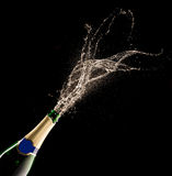 Champagne bottle with splash Stock Images