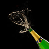 Champagne bottle with splash Stock Photos