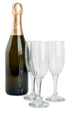 Champagne bottle and three glasses Stock Photo