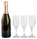 Champagne bottle and three glasses Royalty Free Stock Image