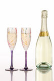 Champagne bottle with two festive glasses Royalty Free Stock Photo