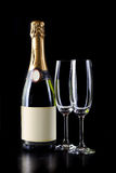 Champagne bottle and two glasses Stock Photos