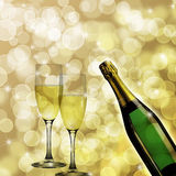 Champagne Bottle and Two Glasses Bokeh Background Stock Photo