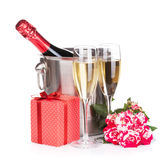 Champagne bottle, two glasses, gift box and red rose flowers Royalty Free Stock Photos