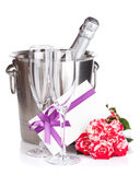 Champagne bottle, two glasses, letter and red rose flowers Stock Photo