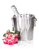 Champagne bottle, two glasses and red rose flowers Stock Image
