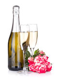 Champagne bottle, two glasses and red rose flowers Stock Photography