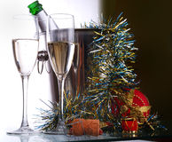 Champagne bottle and wineglasses Royalty Free Stock Images