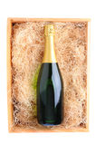 Champagne Bottle in Wood Crate Stock Photography