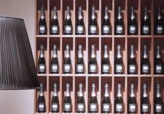 Champagne bottles. Many champagne bottles on shelves Stock Images