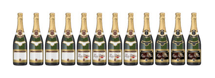 Champagne bottles. Group of champagne bottles - Blank, Christmas and Happy New Year labels Royalty Free Stock Photo