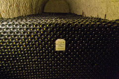 Champagne bottles in cave. 72,00o bottles of champagne in caves of Champagne, France Royalty Free Stock Image