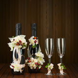 Champagne Bottles with Glass and Wedding Decoration of Flower Ar Royalty Free Stock Images