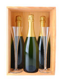 Champagne Bottles and Glasses in Wood Case Stock Photo