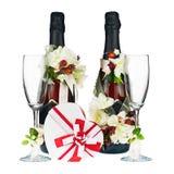 Champagne Bottles mit Glas-und Hochzeits-Dekoration der Blume AR Stockfoto