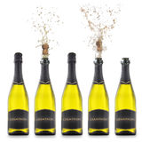 Champagne bottles with popping corks isolated Stock Photo