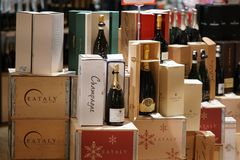 Champagne bottles. Rome, Italy - December 22, 2017: Champagne bottles on Eataly supermarket shelf. Eataly is the Italian upscale food and beverages emporium Stock Images