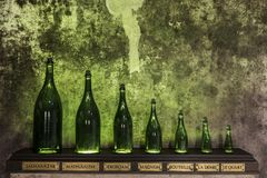 Champagne Bottles Size. Reims, France - June 14, 2017: the caves of Champagne House Mumm with different sizes of bottles, France Stock Images