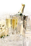 Champagne and a bouquet of roses Stock Photography