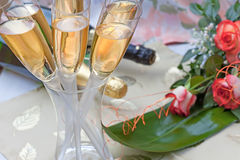 Champagne and bouquet of roses Royalty Free Stock Image