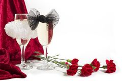 Champagne with bow knots Royalty Free Stock Images
