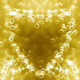 Champagne bubblar i forma av en hjärta Fotografering för Bildbyråer