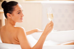 Champagne in bubble bath. Stock Photo