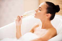 Champagne and bubble bath. Stock Photography