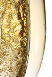 Champagne bubbles. Two champagne flutes full to the brim with champagne and bubbles Royalty Free Stock Photo