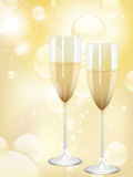 Champagne and bubbles background. Champagne flutes on an abstract bubble background Royalty Free Stock Images