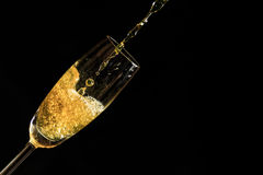 Champagne and Bubbles. Champagne pouring into a glass, lots of bubbles. Celebration of a new year Royalty Free Stock Photo